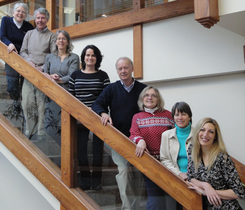 Image of ETS staff on stairs leading to office entrance